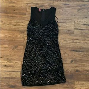 Bebe black bandage dress with sequin details!